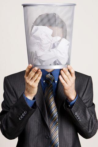 Bigstock-Young-man-holding-a-trash-bin--26453660