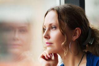 Bigstock-Beautiful-woman-looking-throug-20311445